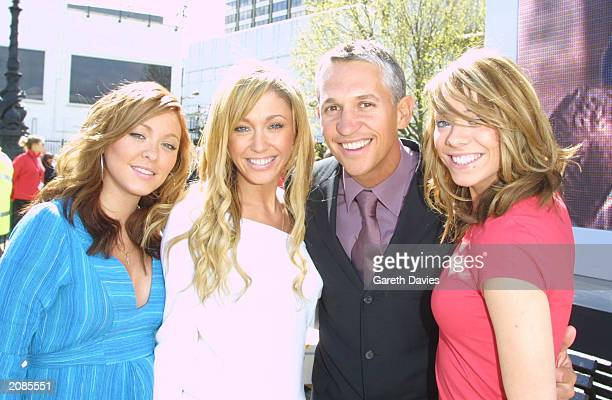 England soccer legend Gary Lineker poses with Atomic Kitten's Natasha Hamilton Jenny Frost and Liz McClarnon during the launch of TMobile central...