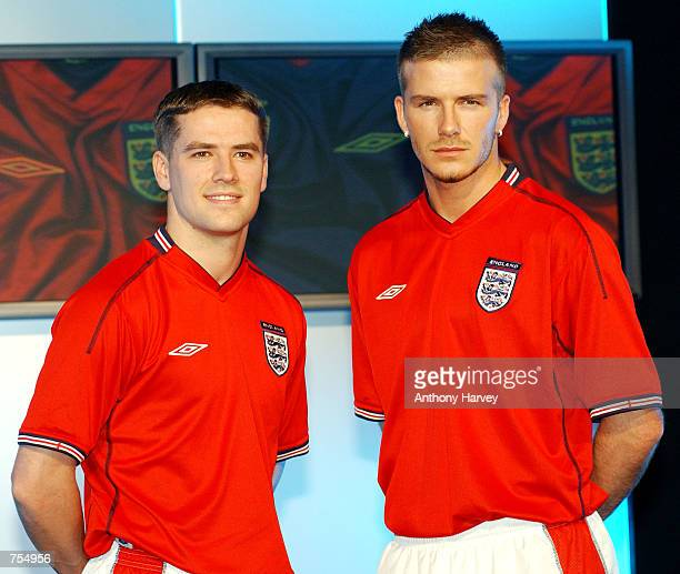 England soccer team captain David Beckham and teammate Michael Owen model the new England away stripa red shortsleeved shirt white shorts and red...
