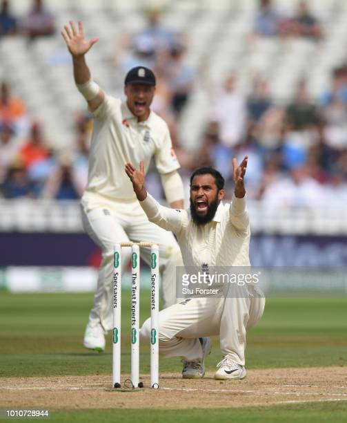 England spinner Adil Rashid appeals with success after appeal for the wicket of Ishant Sharma during day 4 of the First Specsavers Test Match between...