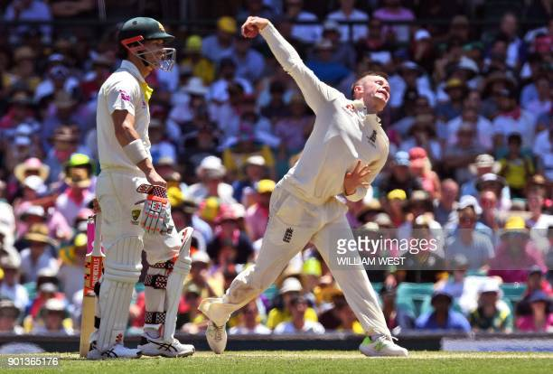 England spinner Mason Crane sends down a delivery as Australia's batsman David Warner looks on on the second day of the fifth Ashes cricket Test...