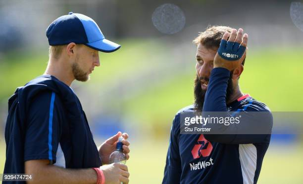 England spinner Moeen Ali chats with captain Joe Root during England nets ahead of the second test match against the New Zealand Black Caps at Hagley...