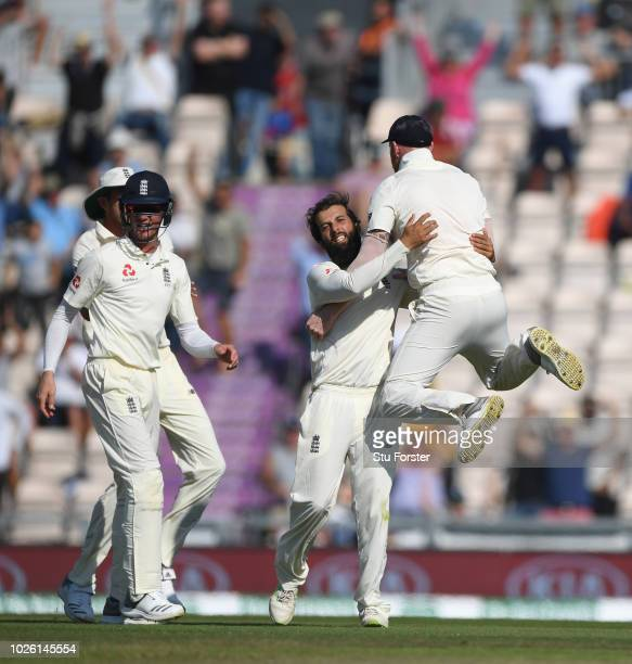 England spinner Moeen Ali is congratulated by Ben Stokes after dismissing Virat Kohli after review during the 4th Specsavers Test Match between...