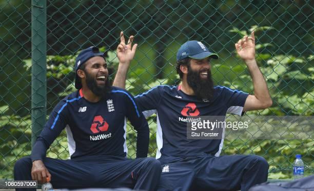 England spinners Adil Rashid and Moeen Ali share a joke during England nets at Pallekelle Stadium on November 12 2018 in Kandy Sri Lanka