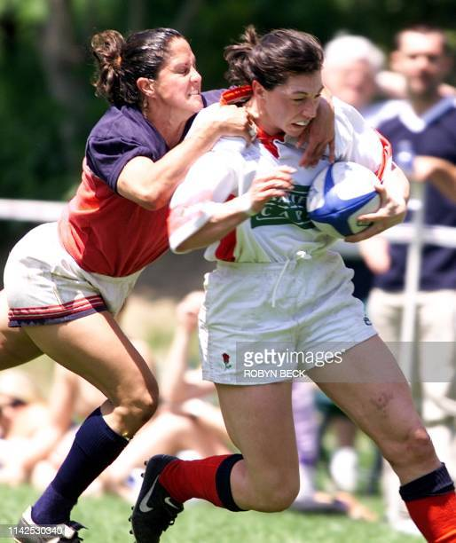 England Stormers NIcky Crawford gets a high tackle from USA Eagles Laura Cabrera on the opening day of the EKong Women's Rugby Seven's tournament and...