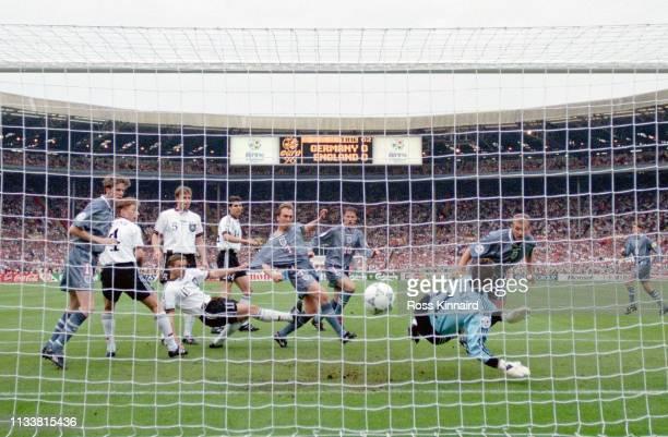 England striker Alan Shearer heads in the England goal past goalkeeper Andreas Kopke as team mates Steve McManaman David Platt and Teddy Sheringham...