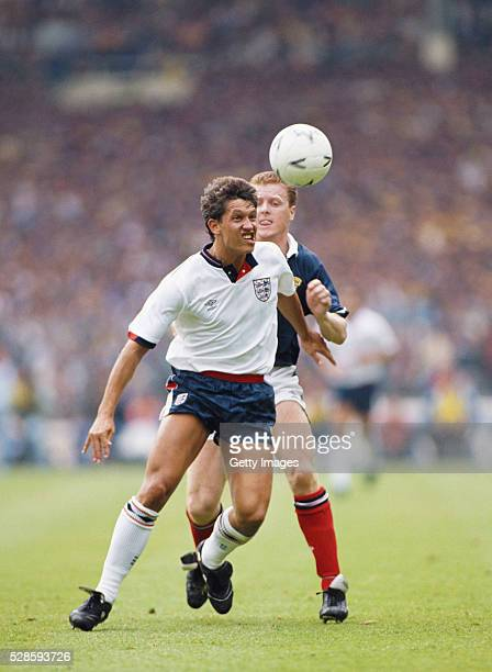 England striker Gary Lineker holds off the challenge of Scotland player Steve Nicol during the Rous Cup International match between England and...