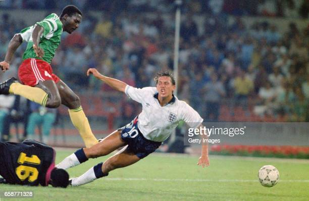 England striker Gary Lineker is tripped by Cameroon's goalkeeper Thomas N'Kono during the 1990 FIFA World Cup quarter final match between England and...