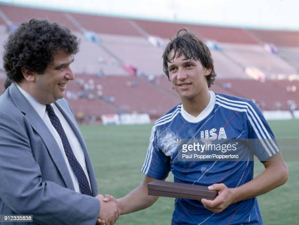 England striker Gary Lineker receives an award from Chuck Blazer the United States Soccer Federation executive vice president following the...