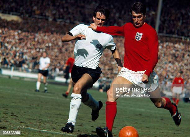 England striker Geoff Hurst moves past West Germany defender Wolfgang Overath to score the 4th goal, completing his hat-trick, in the last minute of...