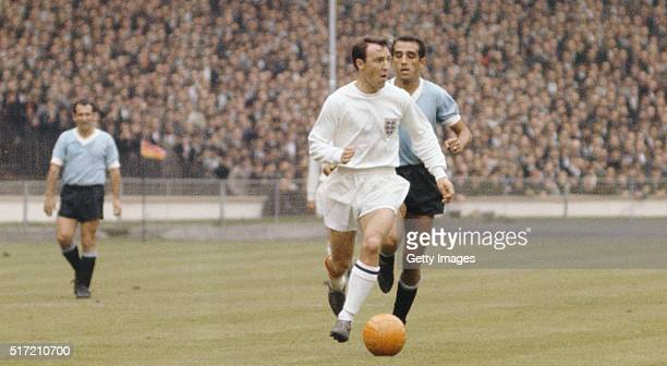 England striker Jimmy Greaves outpaces a Uruguay defender during the 1966 FIFA World Cup Finals group A match between England and Uruguay at Wembley...