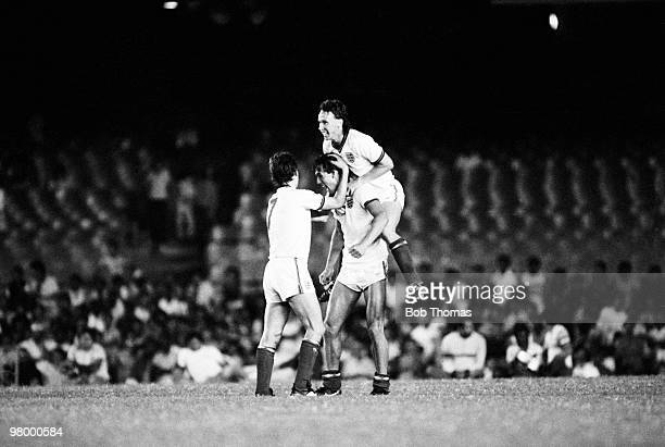 England striker Mark Hateley is congratulated by teammates Bryan Robson and Mike Duxbury after scoring England's second goal against Brazil during...