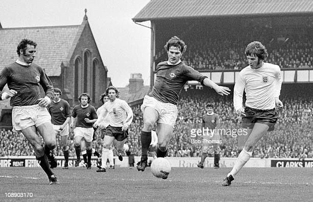 England striker Mike Channon and Pat Rice of Northern Ireland battle for the ball during the International match played at Goodison Park, Liverpool...