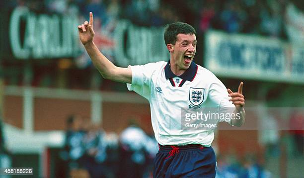 England striker Robbie Fowler celebrates after scoring his second goal in a 41 win over the Netherlands during the UEFA European Under18 Championship...