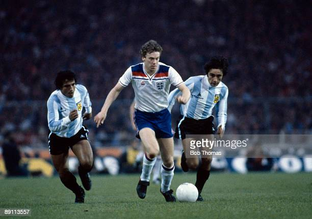 England striker Tony Woodcock is chased by two Argentinian defenders during the International friendly match between England and Argentina at Wembley...