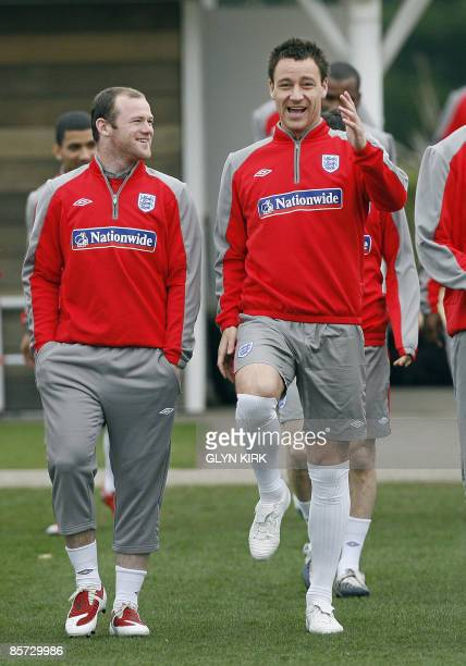 England striker Wayne Rooney and defender John Terry attend a training session for the forthcoming World Cup Qualifying match against Ukraine, London...