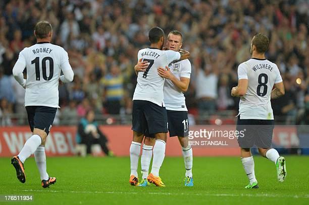 England striker Wayne Rooney and England midfielder Jack Wilshere run in to celebrate with England midfielder Theo Walcott and England midfielder Tom...
