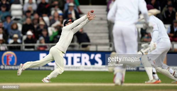 England sub fielder Mason Crane dives to catch Roston Chase during day five of the 2nd Investec Test Match between England and West Indies at...