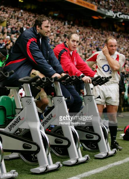 England substitutes Danny Grewcock Shaun Perry and Perry Freshwater warm up on the sidelines during the RBS Six Nations Championship match between...