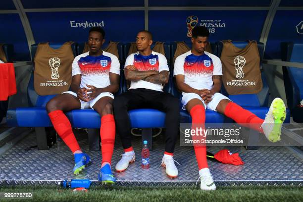 England substitutes Danny Welbeck Ashley Young and Marcus Rashford sit in the dugout during the 2018 FIFA World Cup Russia 3rd Place Playoff match...