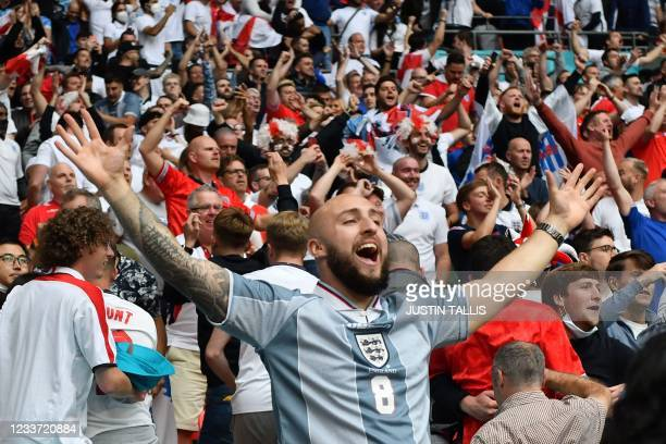 England supporters celebarate their opening goal during the UEFA EURO 2020 round of 16 football match between England and Germany at Wembley Stadium...