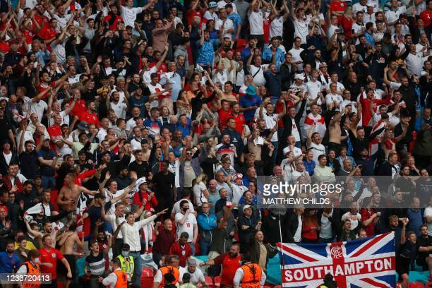 England supporters celebrate their second goal during the UEFA EURO 2020 round of 16 football match between England and Germany at Wembley Stadium in...