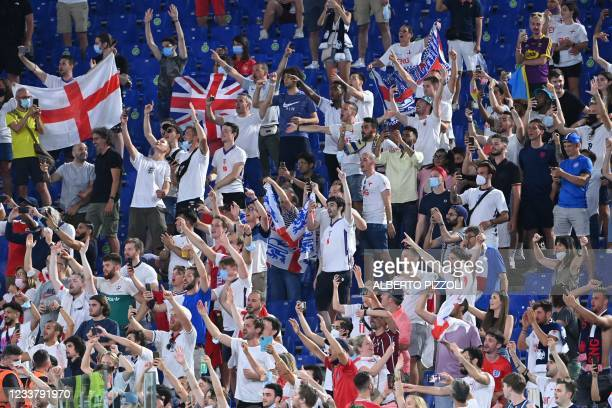 England supporters celebrate their win in the UEFA EURO 2020 quarter-final football match between Ukraine and England at the Olympic Stadium in Rome...