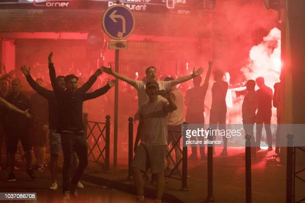England supporters gesture towards a line of police officers in Lille France 15 June 2016 England will face Wales in a UEFA EURO 2016 group B...