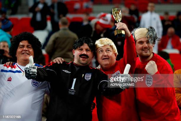 England supporters in fancy dress mimicking the 1966 world cup winning team pose for a picture ahead of the UEFA Euro 2020 qualifying first round...