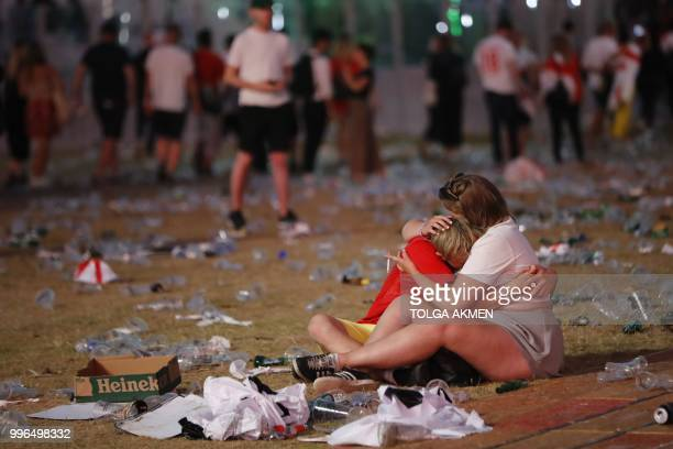 TOPSHOT England supporters react at an outdoor screening in Hyde Park in central London as England lose the 2018 World Cup semifinal against Croatia...