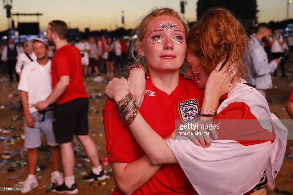 TOPSHOT - England supporters react at an outdoor screening in Hyde Park in central London as England lose the 2018 World Cup semi-final against Croatia in Moscow on July 11, 2018.