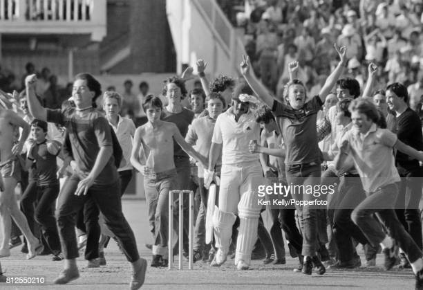 England supporters run onto the field to celebrate England batsman Allan Lamb's century during the 1st Prudential Trophy One Day International...