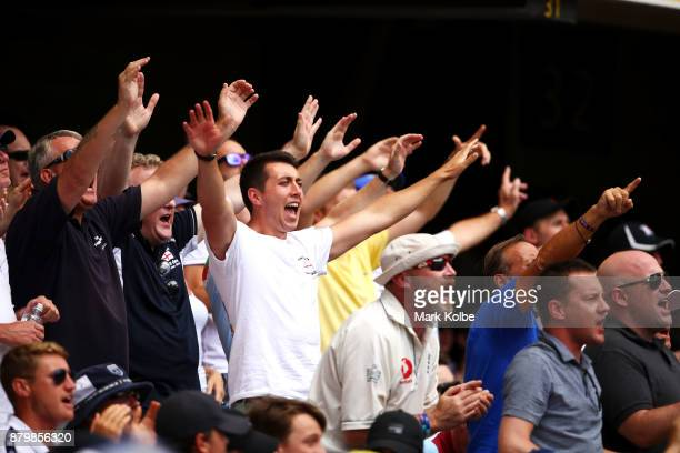 England supporters sing during day five of the First Test Match of the 2017/18 Ashes Series between Australia and England at The Gabba on November 27...