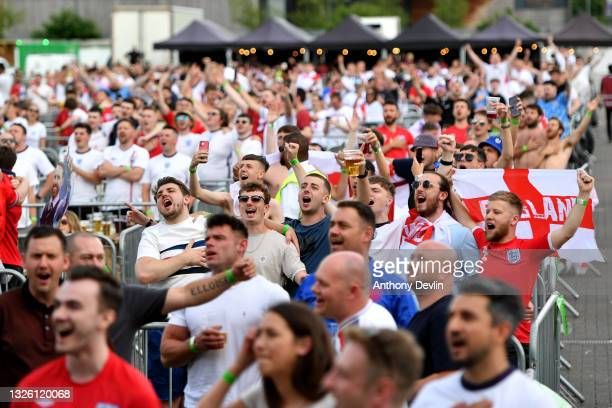 England supporters sing the national anthem before kick-off at the 4TheFans Fan Park at Event City as England Play Germany for a place in the Euro...