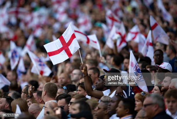 England supporters wave flags during the International Friendly between England and Nigeria at Wembley Stadium on June 2 2018 in London England
