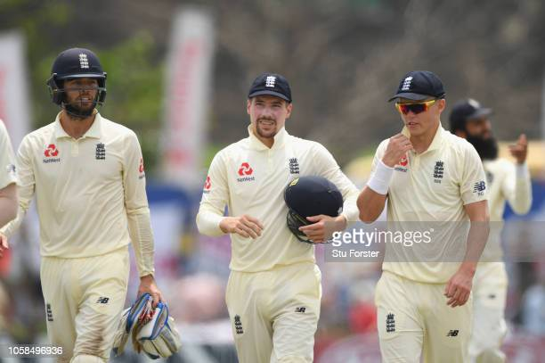 England Surrey players keeper Ben Foakes Rory Burns and Sam Curran chat as they leave the field at lunchtime during Day Two of the First Test match...