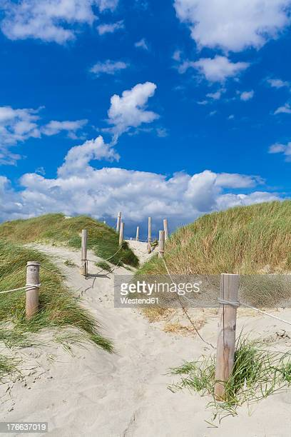 England, Sussex, Chichester, Way through sand dune on beach at West Wittering