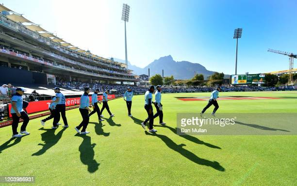 England take to te field during the First One Day International match between South Africa and England at Newlands on February 04, 2020 in Cape Town,...
