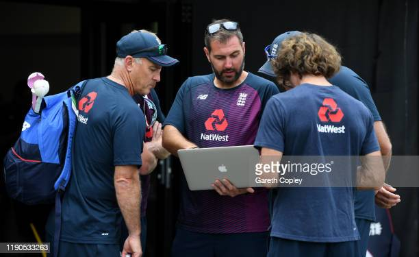England team analyst Giles Lindsay speaks with coaches Graham Thorpe, Chris Silverwood and Bruce French during a nets session at Seddon Park on...