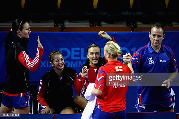 England team celebrates winning against Nigeria in the Women's Team preliminary at Yamuna Sports Complex during day one of the Delhi 2010...
