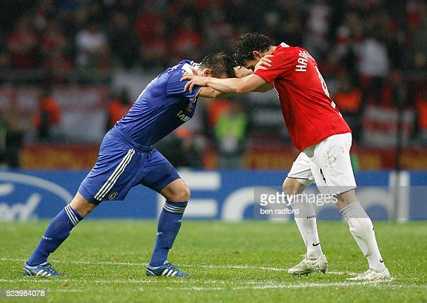 England team mates Frank Lampard of Chelsea and Owen Hargreaves Manchester United help each other recover from cramp of during the UEFA Champions...