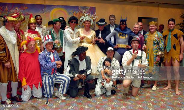 England team members and management wear fancy dress costumes before the traditional Christmas Lunch in Melbourne Australia for the England cricket...