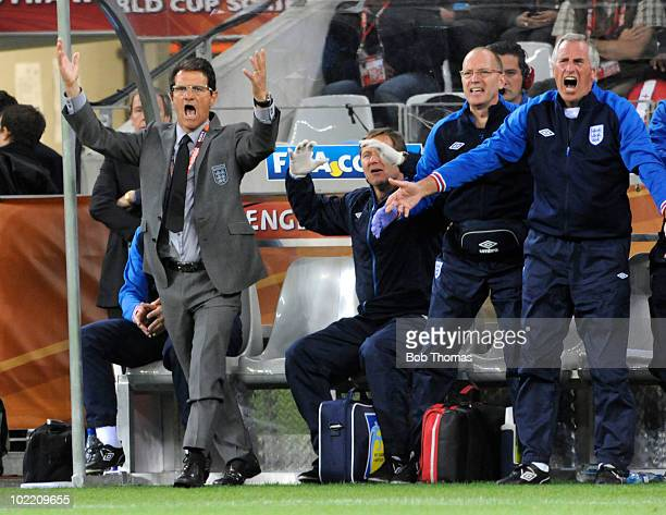 England team officials on the bench, including coach Fabio Capello , react during the 2010 FIFA World Cup South Africa Group C match between England...