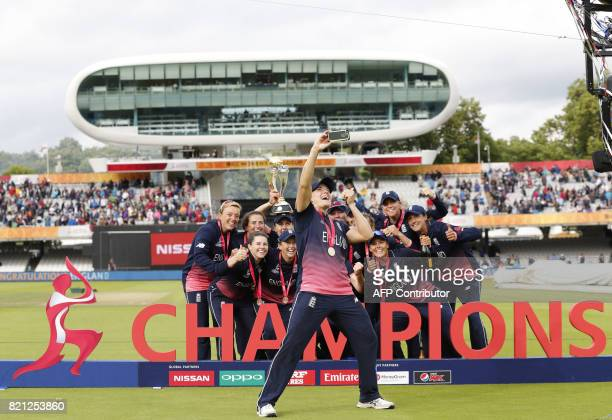 England team players pose after winning the ICC Women's World Cup cricket final between England and India at Lord's cricket ground in London on July...