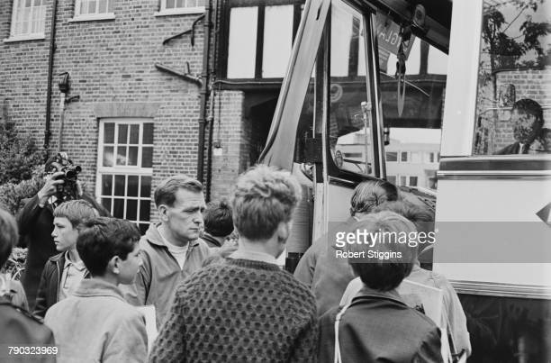 England team trainer Les Cocker among fans at the door of the England team bus outside the Hendon Hall Hotel Hendon London during the 1966 World Cup...
