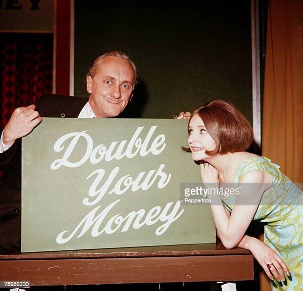 England Television presenter Hughie Green and hostess Monica Rose are pictured on the set of the quiz show 'Double Your Money'