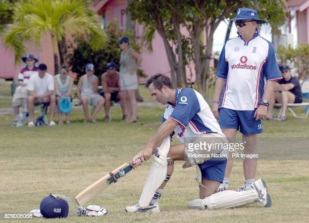 England Test captain Michael Vaughan practices his sweep shot watched by coach Duncan Fletcher during net practice at the team hotel Antigua
