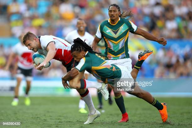 England Tom Mitchell is tackled by South Africa Rosko Specman in the Men's Bronze Medal Rugby Sevens Match between South Africa and England on day 11...