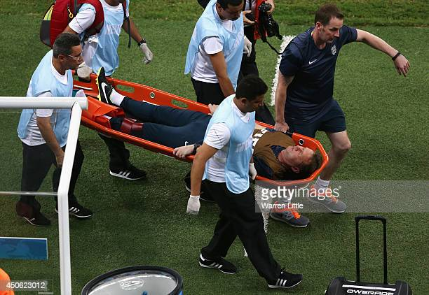 England trainer Gary Lewin is stretchered off the field after a leg injury during the 2014 FIFA World Cup Brazil Group D match between England and...