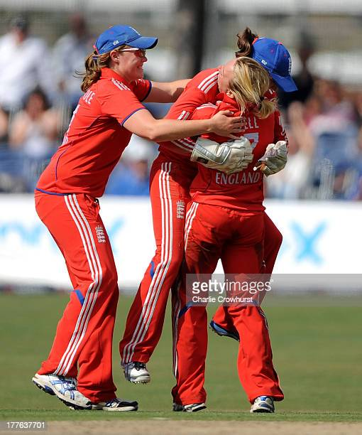 England trio Anya Shrubsole, Danielle Hazell and Sarah Taylor celebrate the wicket of Jodie Fields of Australia during the England Women and...