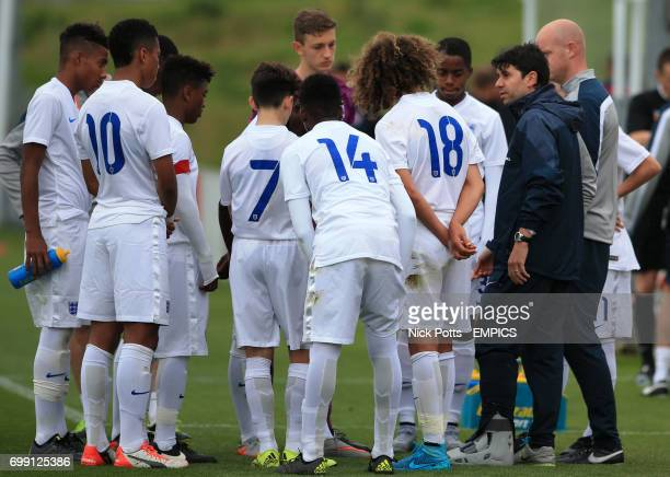 England U16's Head coach Dan Micciche speaks to his players at half time